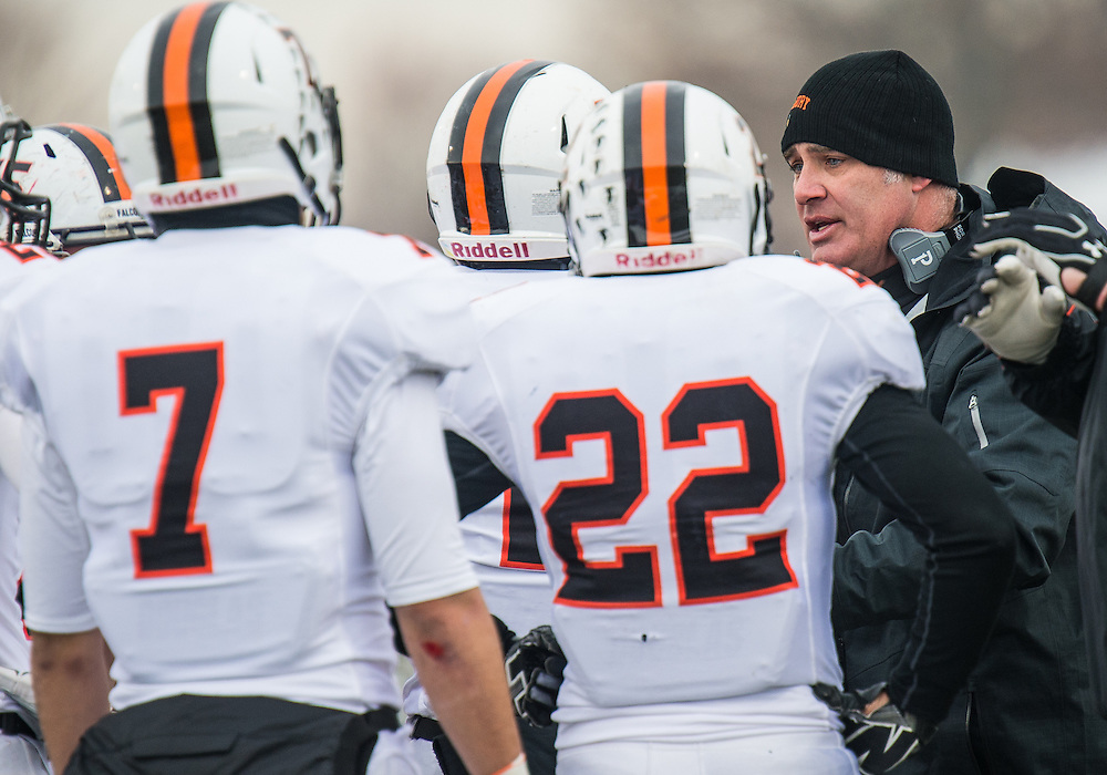 Pennsbury Head Coach Galen Snyder explains the next play to his players during a timeout of the PIAA District 1 Football Championship game in Franconia, Pa, Saturday, November 29, 2014. Photo by Bryan Woolston / @woolstonphoto.