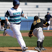 UNCW's Corey Dick is forces out at first by VCU'sTrevor Marino. (Jason A. Frizzelle)