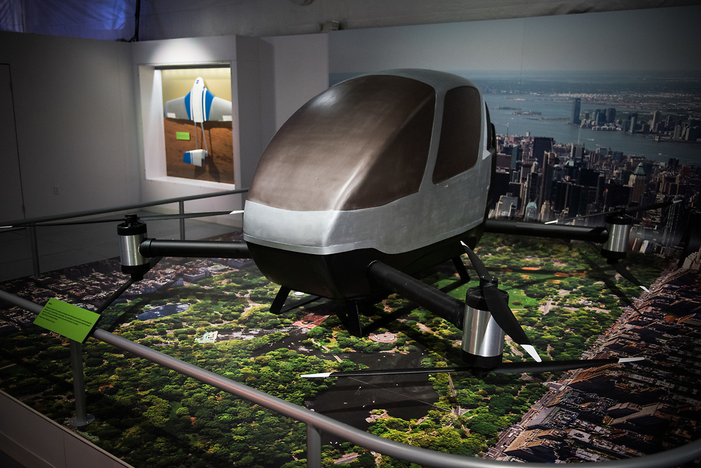 """30206010A - DRONES - A model of a Kairos flying car concept by Urban Aerial Solutions sits on display at the """"Drones: Is the Sky the Limit?"""" exhibit at the Intrepid Sea, Air, and Space Museum in New York, NY on May 9, 2017."""
