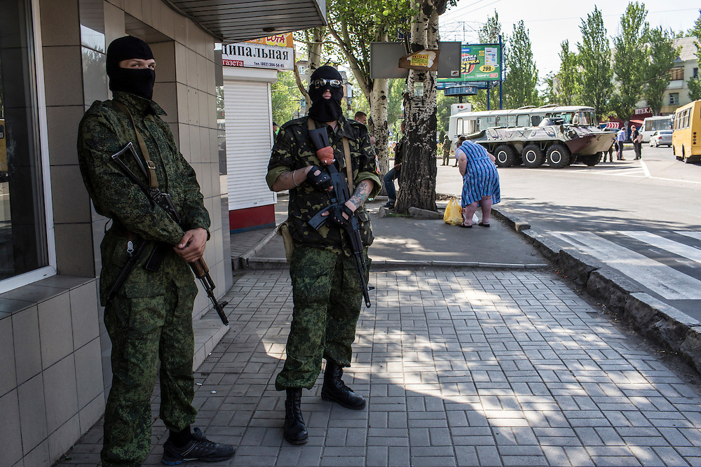 DONETSK, UKRAINE - MAY 20: Members of the Vostok Battalion, a pro-Russia militia, stand guard in an intersection on May 20, 2014 in Donetsk, Ukraine. A week before presidential elections are scheduled, questions remain whether the eastern regions of Donetsk and Luhansk are stable enough to administer the vote. (Photo by Brendan Hoffman/Getty Images) *** Local Caption ***