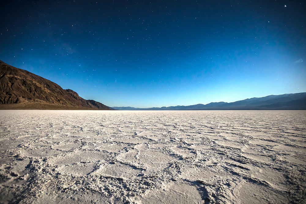 """""""Badwater Basin at Night 2"""" - Predawn photograph of the Badwater Basin salt flat in Death Valley, California. The Milky Way can be seen in the sky."""