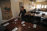 Heather Snead prepares the tables at Yocona River Inn restaurant in Abbeville, Miss. on Sunday, February 28, 2010.