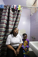 Catrina Heines and her daughter. Both diagnosed with asthma. Melrose Houses, Bronx, NY, 2012.