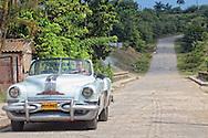 Pontiac convertible in Arcos de Canasi, Mayabeque, Cuba.