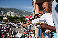 Haitian presidential candidate Michel Martelly arrives to cast his ballot on November 28, 2010 in Port-au-Prince, Haiti.