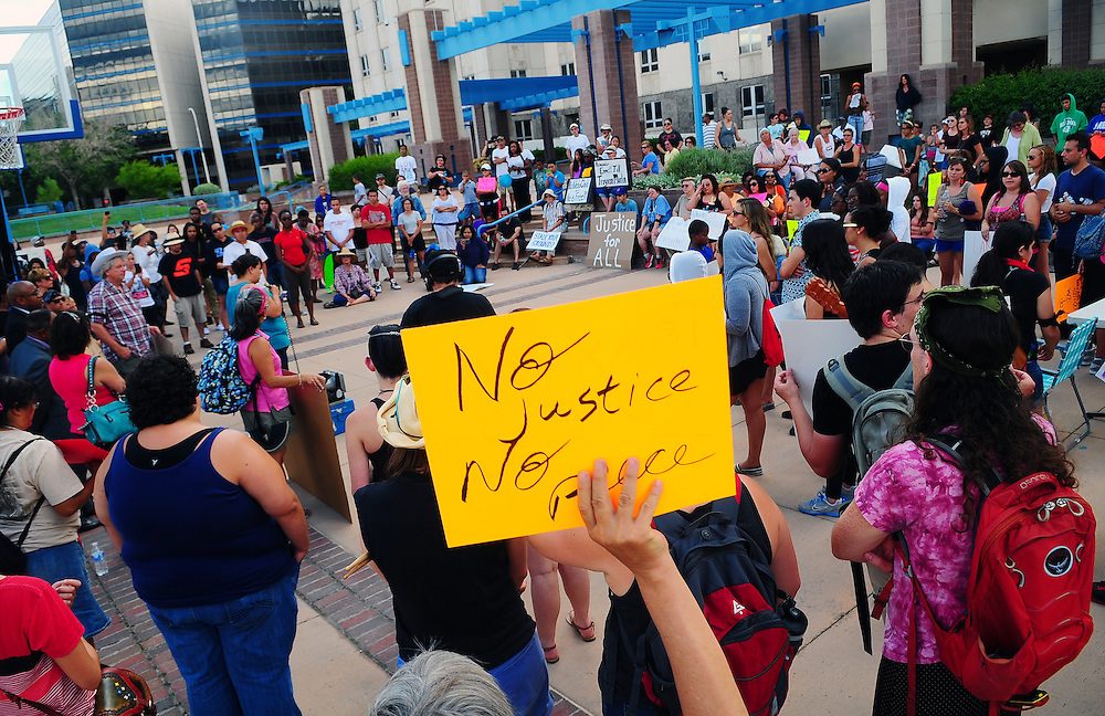 apl071413e/ASECTION/Pierre-Louis/Albuquerque Journal/071413 <br /> A man holds a sign  at a rally to protest the not-guilty  verdict of George Zimmerman , for the fatal shooting of Trayvon Martin,, . About 200 people took part at the event held at Civic Plaza  on  Sunday July 14, 2013 . (Adolphe Pierre-Louis-Journal)