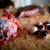 Cows brain and eyes on the chopping block at Basurto market near Cartagena, Colombia...Photo by Robert Caplin.