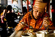 dining at one of the many restaurants that ajoin the Saturday night  market in Kuching