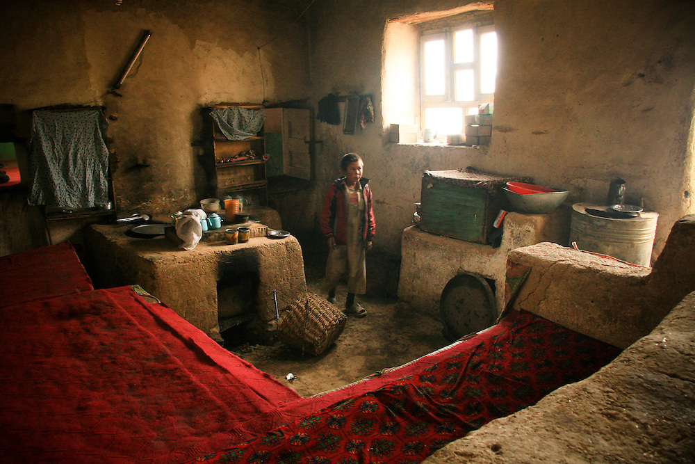 An Afghan boy works at a cafe in Bamiyan, Afghanistan, August 10, 2007.