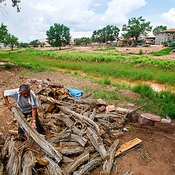 080213       Brian Leddy<br /> Wilbur Haluacwa piles wood on his property next to the Zuni River in Zuni on Friday. Haluacwa, who has lived at the location for about 30 years has not seen the river flow in a long time. &quot;It's been too long, probably at least 20 years,&quot; he said.