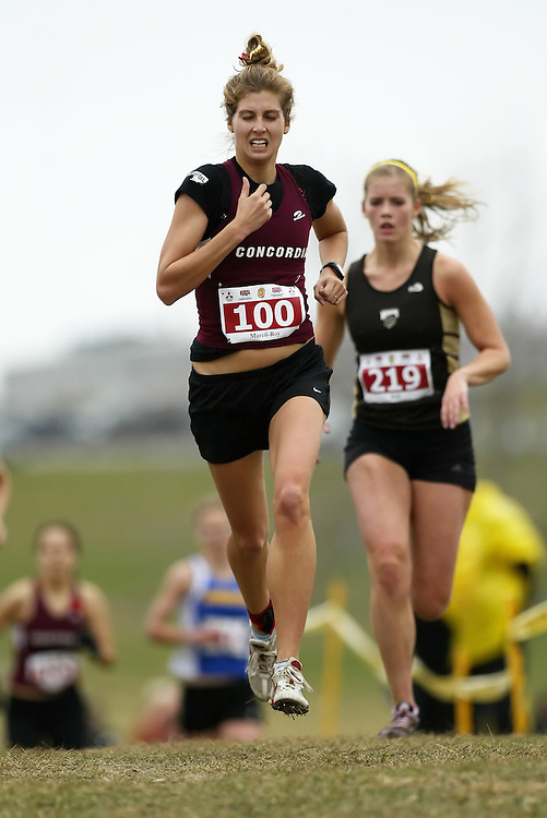 (Kingston, Ontario -- 14 Nov 2009)  AMELIE MARCIL-ROY of the Concordia University runs to 117 place at the  2009 Canadian Interuniversity Sport CIS Cross Country Championships at Forth Henry Hill in Kingston Ontario. Photograph copyright Sean Burges / Mundo Sport Images, 2009.