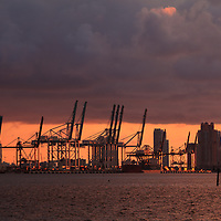 The port of Miami, Florida with Miami Beach condo buildings in the background, at sunrise.