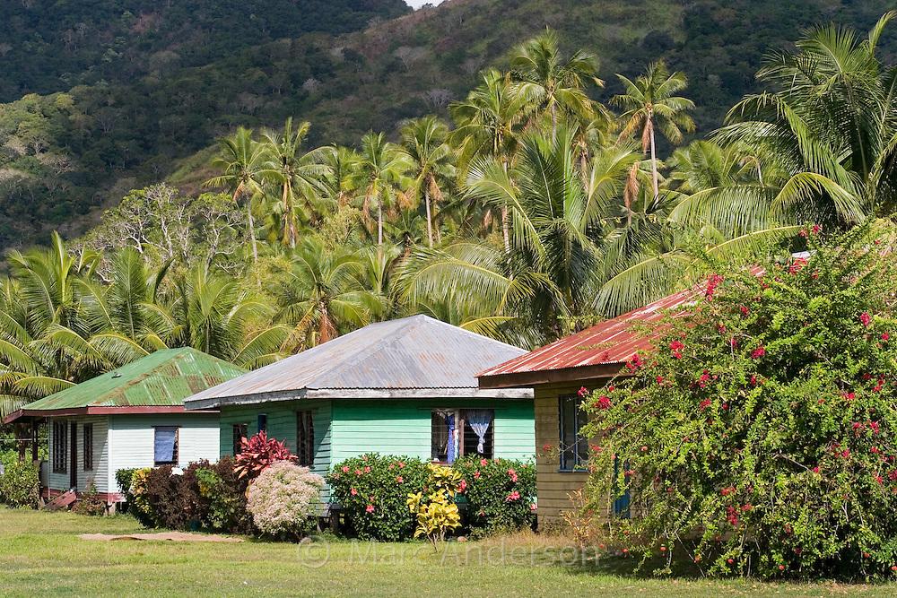 Colourful village houses in a small village in Vanua Levu, Fiji..