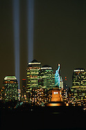 Statue of Liberty, and Lower Manhattan, Tribute in Light, vertical columns of light in remembrance of the September 11 attacks on the Twin Towers of the World Trade Center,nNew York City, New York, USA c. 2002