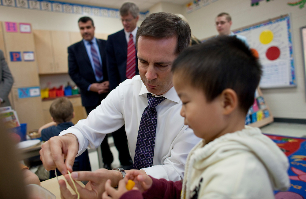 London, Ontario ---10-10-08---   Premier Dalton McGuinty builds necklaces with Alex You, 4, in a full day kindergarten class at Stoney Creek Public School in London, Ontario, October 8, 2010.<br /> GEOFF ROBINS The Globe and Mail