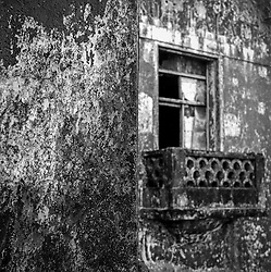 Detail of worn building front and balcony of Bokor Palace Hotel at <br /> <br /> Bokor Hill Station, <br /> <br /> Bokor, Kampot, Cambodia, 2005, Southeast Asia