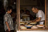 Vendors at an 80 year old porridge shop on Pantai Street