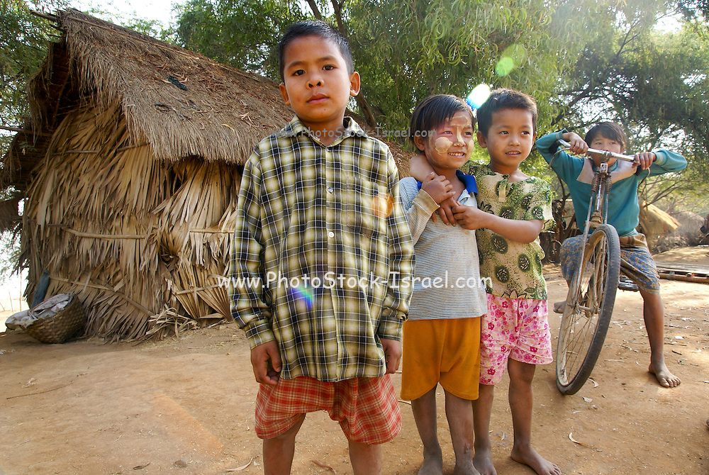 Myanmar, Pakokku, Smiling young children on the banks of the Chindwin river