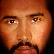 Rajav Mohammad, 22, said by local Afghan commanders to be an al Qaeda fighter, sits calmly after being captured.