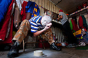 Jahirt Bermudez, of Colombia, South America, performs as Perolito the clown for the Cole Bros. Circus, prepares his makeup for a show.
