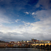 "SHOT 11/21/08 7:41:38 AM -  The Prague Castle and Charles Bridge in Prague, Czech Republic. Prague Castle (Czech: Pra?ský hrad) is a castle in Prague where the Czech kings, Holy Roman Emperors and presidents of Czechoslovakia and the Czech Republic have had their offices. The Czech Crown Jewels are kept here. Prague Castle is one of the biggest castles in the world (according to Guinness Book of Records the biggest ancient castle) at about 570 meters in length and an average of about 130 meters wide. Charles Bridge is a famous historical bridge that crosses the Vltava river in Prague, Czech Republic. The bridge is 516 meters long and nearly 10 meters wide, resting on 16 arches shielded by ice guards. It is protected by three bridge towers, two of them on the Lesser Quarter side and the third one on the Old Town side. The Old Town bridge tower is often considered to be one of the most astonishing civil gothic-style buildings in the world. The bridge is decorated by a continuous alley of 30 statues and statuaries, most of them baroque-style, erected around 1700. Prague is the capital and largest city of the Czech Republic. Its official name is Hlavní m?sto Praha, meaning Prague, the Capital City. Situated on the River Vltava in central Bohemia, Prague has been the political, cultural, and economic centre of the Czech state for over 1100 years. The city proper is home to more than 1.2 million people, while its metropolitan area is estimated to have a population of over 1.9 million. Since 1992, the extensive historic centre of Prague has been included in the UNESCO list of World Heritage Sites. According to Guinness World Records, Prague Castle is the largest ancient castle in the world. Nicknames for Prague have included ""the mother of cities"", ""city of a hundred spires"" and ""the golden city"". Since the fall of the Iron Curtain, Prague has become one of Europe's (and the world's) most popular tourist destinations. It is the sixth most-visited European city after London"