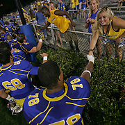 Delaware Offensive Tackle Erle Ladson #78 shakes hand with  a fan after a week 1 win over West Chester...Delaware will return home Sept. 8, 2012 at 3:30pm for a showdown with interstate Rival Delaware State in the Route 1 Rivalry Bowl at Delaware Stadium.