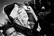 &quot;NOTE&quot; small digital files !<br /> On Nov. 11 2004, Yassir Arafat died at a french military hospital. The day after, world leaders honored him at a ceromony in Cairo and afterwards his casket was brought by helicopter to his compound in Ramallah &ndash; The compound in which Israel confined him for years. Amid houndreds of thousands of  chaotic and highly emotional mourners Yasser Arafat was buried. He died at the age of 75. <br /> Mourners at the wall surrounding the Arafat compound.
