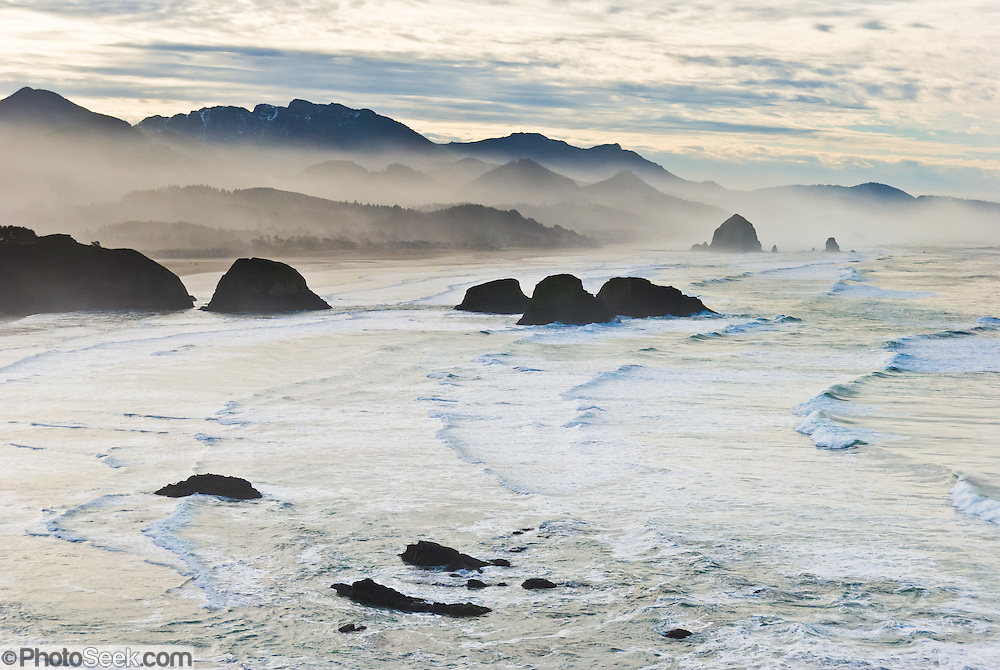 The pounding Pacific Ocean has eroded bluffs to create Haystack Rock, a 235-foot (72-meter) tall monolith and many other sea stacks, on Cannon Beach, on the Oregon coast, at Ecola State Park. Haystack Rock is part of the Tolovana Beach State Recreation Site and is managed by Oregon Parks and Recreation below the mean high water (MHW) level, and above the MHW level by the Oregon Islands National Wildlife Refuge of the United States Fish and Wildlife Service.
