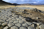 Basalt columns form a natural floor at Kirkjugólf in southern Iceland, not far from Kirkjubaejarklaustur. People used to think that the floor was an old church floor, but it is a natural area of the tops of volcanic basalt columns.