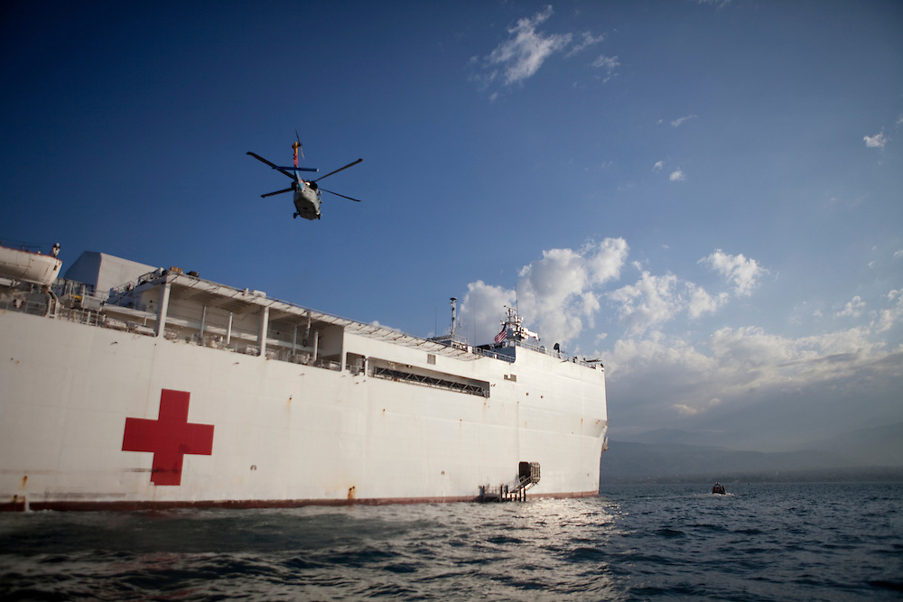 An MH-60S helicopter lands on board the USNS Comfort, a naval hospital ship, off the coast of Port-au-Prince, Haiti on Wednesday, January 20, 2010. The Comfort deployed from Baltimore, bringing nearly a thousand medical personnel to care for victims of Haiti's recent earthquake.