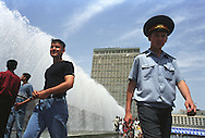 Uzbek policeman strolls through the crowds celebrating Victory Day in Tashkent, Uzbekistan.