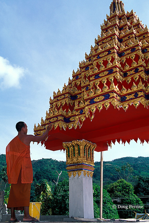 Buddhist monk painting Wat Patong temple on Phuket Island, Thailand