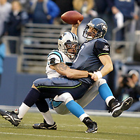 Seattle Seahawks quarterback Matt Hasselbeck is sacked by Dan Morgan of the Carolina Panthers during the first quarter of the NFC Championship game.<br />