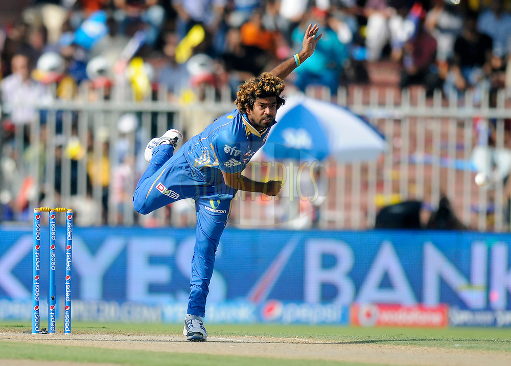 Lasith Malinga of the Mumbai Indians bowls during match 16 of the Pepsi Indian Premier League 2014 between the Delhi Daredevils and the Mumbai Indians held at the Sharjah Cricket Stadium, Sharjah, United Arab Emirates on the 27th April 2014<br /> <br /> Photo by Pal Pillai / IPL / SPORTZPICS