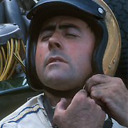 """Jack Brabham, 3 times Formula 1 world champion (1959, 1960 e 1966), preparing for start at Belgian Grand Prix at Spa Francorchamps in 1967. At 41 he was nicknamed """"the old man""""."""