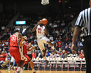 "Ole Miss' Murphy Holloway (31) vs. Rutgers' Austin Johnson (21) at the C.M. ""Tad"" Smith Coliseum in Oxford, Miss. on Saturday, December 1, 2012. (AP Photo/Oxford Eagle, Bruce Newman).."