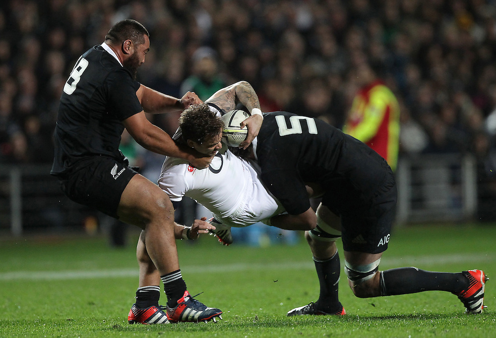 England's Danny Cipriani is tackled by New Zealand's Charlie Faumuina and Samuel Whitelock in an International Rugby Test match, Waikato Stadium, Hamilton, New Zealand, Saturday, June 21, 2014.  Credit:SNPA / David Rowland