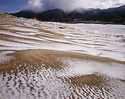 AA00860-02...COLORADO - Fresh snow on the sand dunes in the The Dune Field area of the Great Sand Dunes National Park.