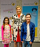 12-5-2014 THE HAGUE  -    Queen maxima visits the Radio 4 Classic Shows is a nationwide fundraising tools for music education for children. The campaign is an initiative of the Radio Shows Classic 4 program and the national Instrument Depot Leerorkest. In a special location broadcast from Radio 4 from primary school 't Palet Hague Queen Máxima presents the first instrument donated to mr. Marco de Souza, founder of the Instrument Depot Leerorkest.COPYRIGHT ROBIN UTRECHT