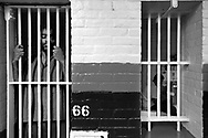 James S. Cheshire, left, who is awaiting trial on using and selling narcotics waits his trial in his cell as next door, Hector Fernandes who is about to be released to a biblical program after serving time for violating his probation reads some of his lawyers paperwork.  The Bristol County Jail & House of Correction located on Ash Street in New Bedford, Massachusetts was started in 1829, and is the oldest running jail in the United States.   The Ash street jail, as it is known, has been a controversial facility since it opened.  It is believed to be the site of the last pubic hanging in Massachusetts sometime in the 1890's.  Two big riots broke out in the 90's (1993, 1998) and since then the facility has been modified to alleviate some of the crowded conditions that resulted in the riots.