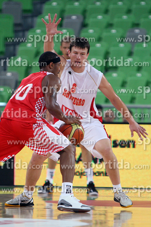 Dominic Draper of Croatia and Suad Sehovic of Montenegro at friendly match between Croatia and Montenegro for Adecco Cup 2011 as part of exhibition games before European Championship Lithuania on August 6, 2011, in SRC Stozice, Ljubljana, Slovenia. (Photo by Urban Urbanc / Sportida)