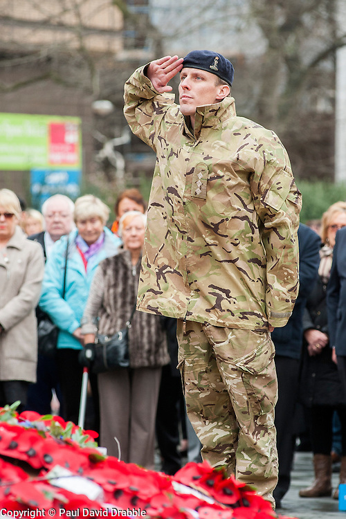 100 years after the outbreak of world War one Veterans, Ex-servicemen Military personnel and members of the public attend the war memorial in Sheffield City centre for the two minute silence and short service as poignant an act of remembrance for those who died in the first world war.<br /> <br /> 11 November 2014<br /> Image &copy; Paul David Drabble <br /> www.pauldaviddrabble.co.uk