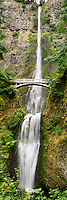 A vertical panoramic view of Multnomah Falls, which is possibly the most famous waterfall in the Columbia River Gorge. This popular tourist spot is seen by millions of people each year.