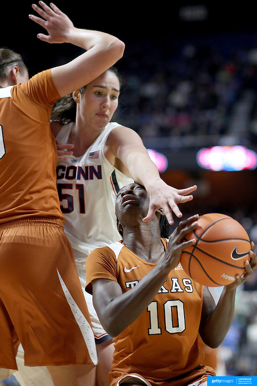 UNCASVILLE, CONNECTICUT- DECEMBER 4: Lashann Higgs #10 of the Texas Longhorns is blocked by Natalie Butler #51 of the Connecticut Huskies during the UConn Huskies Vs Texas Longhorns, NCAA Women's Basketball game in the Jimmy V Classic on December 4th, 2016 at the Mohegan Sun Arena, Uncasville, Connecticut. (Photo by Tim Clayton/Corbis via Getty Images)