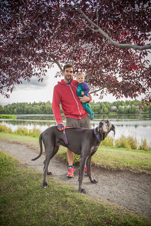 """Gray Shaneberger with his one year old daughter Elsa and his Great Dane, Momo, near Westchester Lagoon in Anchorage.  """"I'm a retired ECHL hockey player...now I hang out with Elsa.""""  glove14@hotmail.com"""