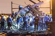 Emergency responders search to find passengers injured during a train derailment in the Frankfort section of  Philadelphia, PA, Tuesday, May 12, 2015.  Bryan Woolston / For the Philadelphia Inquirer