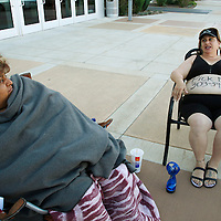 """Shelly Wright (R) third in line with """"Pick Me"""" and her phone number written on her belly waits with Lisa Urquizo (L) first in line for casting for season 11 of """"The Biggest Loser"""" television show in Broomfield, Colorado July 17, 2010. .  Both women spent the night on the sidewalk outside the hall for a chance to be on the show and win $250,000.  Over 600 people attended the casting call.   REUTERS/Rick Wilking (UNITED STATES)"""