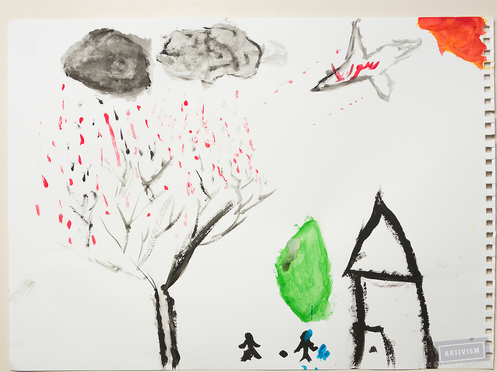 During the war: the clouds cry blood and a plane drops bombs. Drawing by a 10 year old Syrian boy. (Topic for session: draw your impression of life before, during and after the war.)