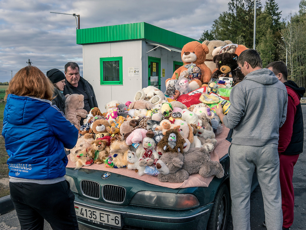 A man sells stuffed animals at a gas station on Sunday, October 11, 2015 in Minsk Oblast, Belarus. Lukashenko, a longtime iron-fisted ruler of Belarus, was elected to a fifth term with a reported 83.5% of the vote, which international monitors said did not meet democratic standards.