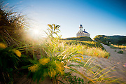 The iconic granite lighthouse known as North Light located at the end of a sandy stretch of beach on the north end of Block Island off Rhode Island's southern shore.